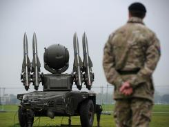 A file picture taken on May 3, 2012, shows a soldier from Britain's Royal Artillery beside a Rapier missile defence system, which could play a role in providing air security during the Olympics, at a photocall in London.