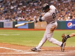 Yankees second baseman Robinson Cano hit the game winning 2-RBI single in the eighth inning against the Rays at Tropicana Field.