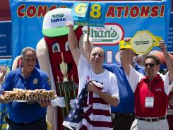 Joey Chestnut celebrates after he wins his sixth straight Coney Island hot dog eating contest on Wednesday.