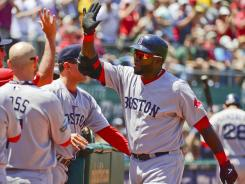 Red Sox designated hitter David Ortiz gets congratulations Wednesday from teammates after his 400th career home run.