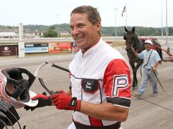 Dave Palone is all smiles after setting the victory record Thursday at The Meadows in Washington, Pa.
