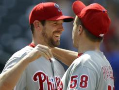 Phillies relief pitcher Jonathan Papelbon (58) congratulates Phillies starting pitcher Cliff Lee after Lee pitched the Phillies to a 9-2 victory over the New York Mets, earning his first victory of the season.