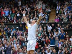 Andy Murray of Britain hears he cheers after he defeated David Ferrer of Spain to reach the Wimbledon semifinals.