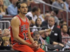 Joakim Noah had hopes of playing in the Olympics but won't because of his injured left ankle.