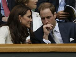 Britain's Prince William, right, and his wife Kate, Duchess of Cambridge, watchRoger Federer of Switzerland and Mikhail Youzhny of Russia at Wimbledon on Wednesday.