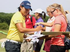 Yani Tseng of Taiwan signs autographs for fans Wednesday during a practice round before the start of the U.S. Women's Open at Blackwolf Run Kohler, Wis.