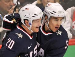 Ryan Suter (20) and forward Zach Parise (9), teammates on the 2010 U.S. Olympic team, will both play for the Minnesota Wild next season.