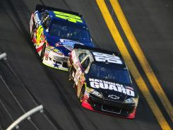 Sprint Cup Series driver Dale Earnhardt Jr. leads Jimmie Johnson during the Coke Zero 400 at Daytona International Speedway last year. TNT's coverage plans for this weekend's race include in-race commercials.
