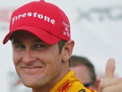 Ryan Hunter-Reay gives a thumbs-up after winning the IndyCar race at the Milwaukee Mile on June 16.