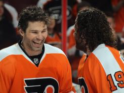 Jaromir Jagr, left, shares a laugh with Scott Hartnell during warmups in this year's playoffs.