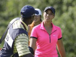 Cheyenne Woods chats with her caddie Reynolds Robinson after teeing off on the 10th hole Thursday at the U.S. Women's Open.