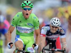 Peter Sagan exults at the finish line after beating Andre Greipel to win Stage 6 of the Tour de France.