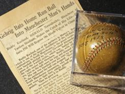 A baseball that Yankees slugger Lou Gehrig hit for a home run in the World Series in 1928 is on display at a convention center in Kansas City, Mo. Elizabeth Gott of Stamford, Conn., is selling the baseball at auction on behalf of her 30-year-old son, Michael, to help pay his medical school debts.