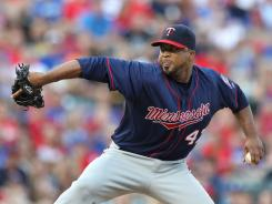Minnesota Twins pitcher Francisco Liriano pitches in the first inning against the Texas Rangers at Rangers Ballpark.