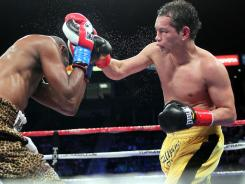 Donaire lands a right hand on Jeffrey Mathebula during their super bantamweight title fight Saturday night. Donaire unified the titles with his victory.