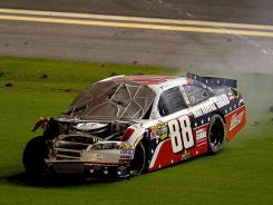 Dale Earnhardt Jr.'s No. 88 Chevrolet spins into the grass on the 160th and final lap of the Coke Zero 400.