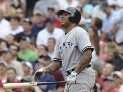 New York Yankees left fielder Andruw Jones hits a home run during the fourth inning against the Boston Red Sox at Fenway Park.