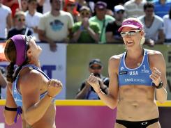 Misty May-Treanor, left, and Kerri Walsh celebrate their first title of the year Saturday at the 1to1 Energy FIVB Grand Slam in Gstaad, Switzerland.
