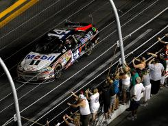 Tony Stewart celebrates his third victory of the season and the fourth Daytona win of his career.