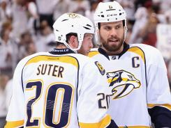 Ryan Suter is gone to Minnesota, but the Predators hope to lock in captain Shea Weber long-term.