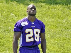 Adrian Peterson, shown here at Vikings minicamp, was arrested in Houston on a charge of resisting arrest.