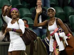 Serena Williams and Venus Williams of the USA celebrate after their doubles victory against Andrea Hlavackova and Lucie Hradecka of the Czech Republic on Saturday at Wimbledon.