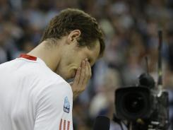 Andy Murray reacts as he speaks to spectators after his defeat to Roger Federer in the men's singles final at Wimbledon.