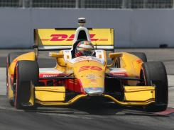 Ryan Hunter-Reay speeds around the Toronto streets for his third win in a row.