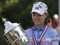 Na Yeon Choi is all smiles after receiving the 2012 U.S. Women's Open trophy Sunday at Blackwolf Run in Kohler, Wis.