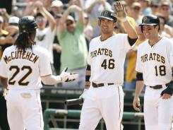 Surprise: Pirates teammates, from left, Andrew McCutchen, Garrett Jones and Neil Walker, shown Sunday, have helped the team to a division lead.