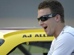 In this Friday, July 6, 2012, photo, AJ Allmendinger helps push his car down pit row during qualifying. NASCAR has temporarily suspended Allmendinger after he failed a drug test.