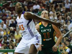 Phoenix Mercury center Nakia Sanford boxes out Seattle Storm center Ewelina Kobryn during the Storm's 83-68 win in Seattle.