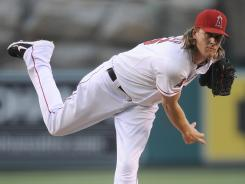 Angels starting pitcher Jered Weaver lowered his ERA to 1.96 after throwing eight shutout innings against the Baltimore Orioles.