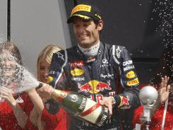 Mark Webber sprays champagne after winning Sunday's British Grand Prix at the Silverstone circuit, in Silverstone, England.