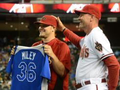 Diamondbacks pitcher Wade Miley, left, is congratulated by manager Kirk Gibson for his All-Star selection.