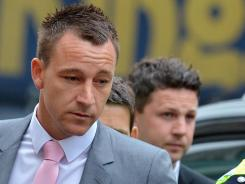 John Terry arrives at Westminster Magistrates court in London on Monday for his trial on charges of racially abusing Anton Ferdinand during a soccer match last year.