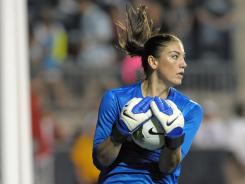 USA goalkeeper Hope Solo cradles the ball after making save against China during the second half of match on May 27.