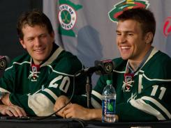 Minnesota Wild defenseman Ryan Suter (left) and forward Zach Parise (right) smile while speaking during their introductory news conference at the Xcel Energy Center.