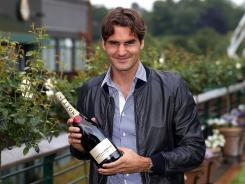 Roger Federer earned a bit of bubbly by winning the Wimbledon men's championship and regaining the No.1 ranking.