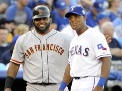 Giants' Pablo Sandoval, left, drove in three runs in the first with a triple.