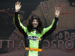 James Hinchcliffe waves at the season-opening Honda Grand Prix while wearing a wig during driver introductions. Hinchcliffe replaced Danica Patrick this season at Andretti Autosport.