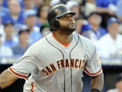 Giants' Pablo Sandoval rips a three-run triple in the first inning off Justin Verlander.