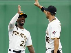 Surprise: Andrew McCutchen, left, and Garrett Jones, shown July 4, helped the Pirates to the NL Central's best first-half record.