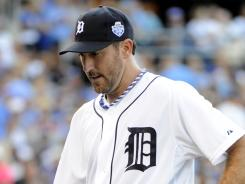 "Lonely walk: AL starting pitcher Justin Verlander of the Tigers heads back to the dugout after giving up five runs to the NL in the first inning of Tuesday's All-Star Game. Said Verlander, who enters the second half 9-5 with a 2.58 ERA, ""I had fun."""