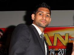 Amir Khan lost his WBA title to Lamont Peterson in December, but was reinstated on an interim basis on Wednesday.