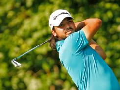 Jason Day will stay at home with his wife and newborn son rather than play next week in the British Open.