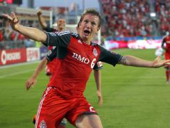 Terry Dunfield of Toronto FC celebrates his game-winning goal in the fifth minute of stoppage time.