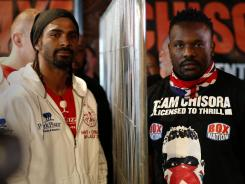 Heavyweight British boxers David Haye, left, and Dereck Chisora are separated by a piece of metal fencing after a press conference on Wednesday in London. The two boxers traded blows following Chisora's loss to Vitali Klitschko in Munich in February, leading to the British Boxing Board of Control to strip Chisora of his license.