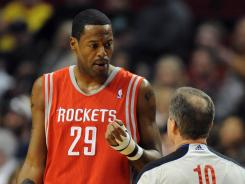 Houston Rockets center Marcus Camby (29) has some words with referee Ron Garretson (10) during the first quarter of the game at the Rose Garden.