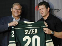 Ryan Suter received a jersey and a 13-year, $98 million contract from Minnesota Wild owner Craig Leipold.